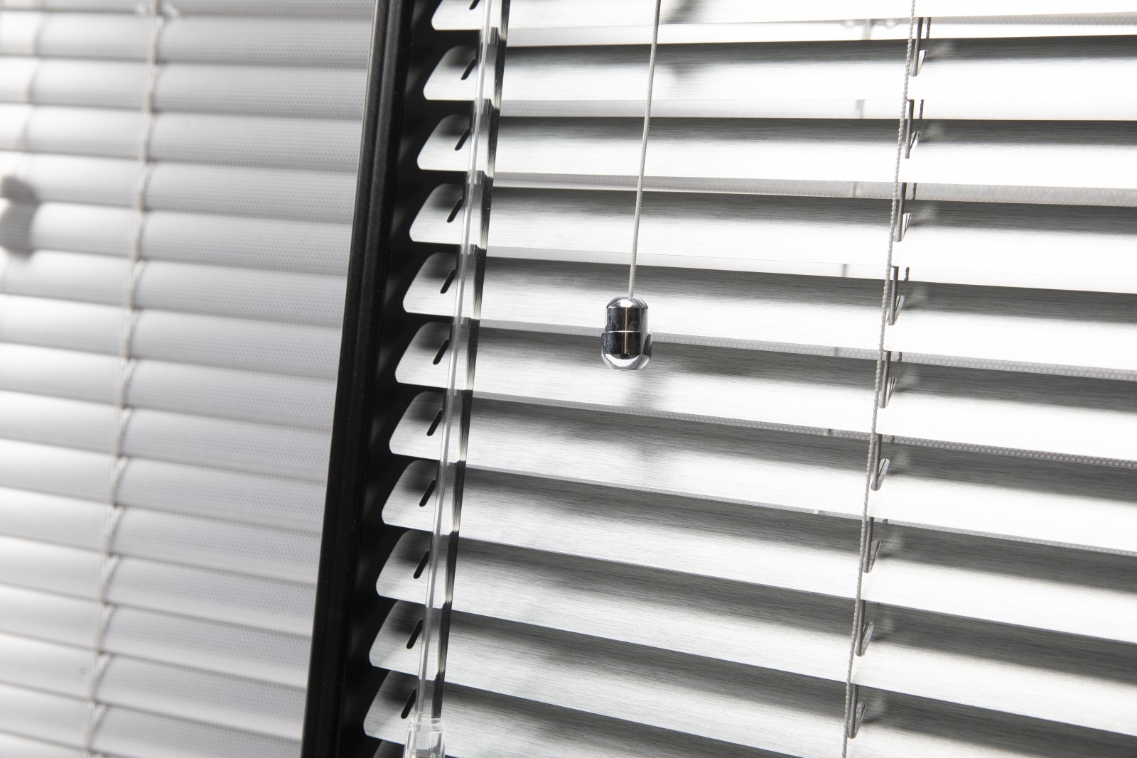 Close up of Aluminium Venetian Blind with Chrome Acorn
